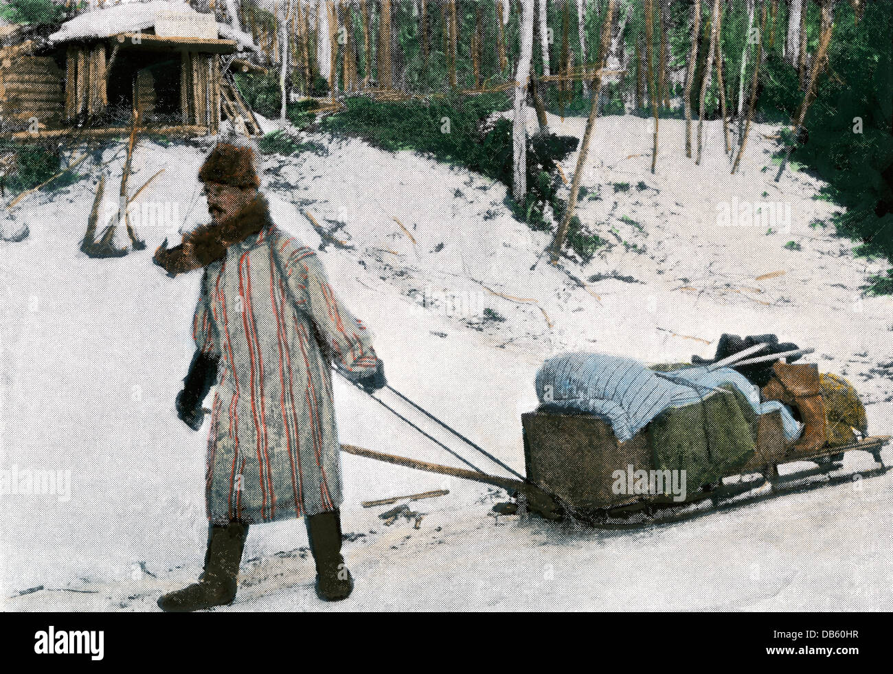 Prospector in the Klondyke with his equipment and sled, 1898. Hand-colored halftone reproduction of a photograph - Stock Image