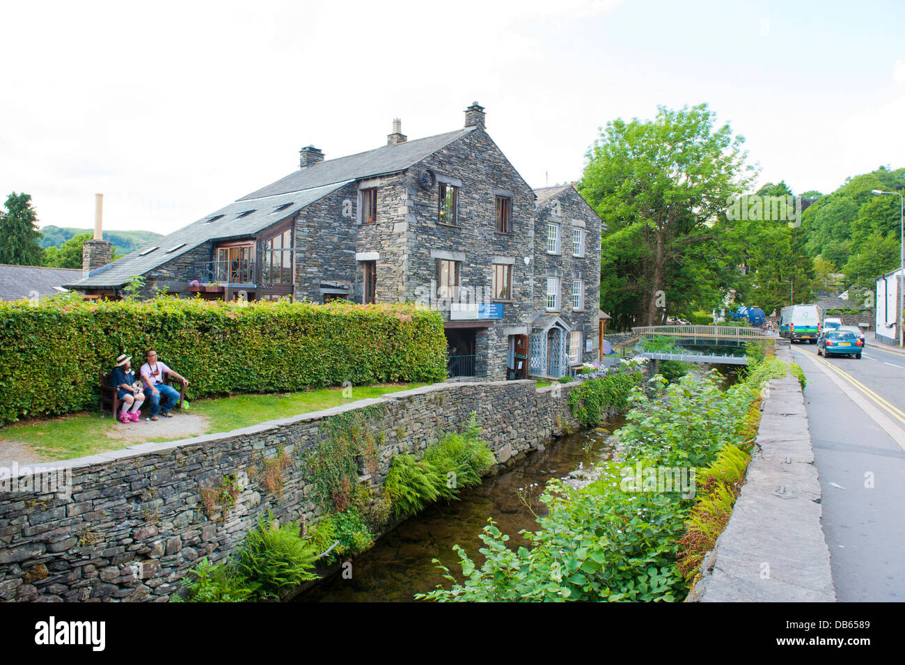The Cumbrian town of Ambleside, a tourist attraction in the Lake District. The Glasshouse restaurant beside the - Stock Image
