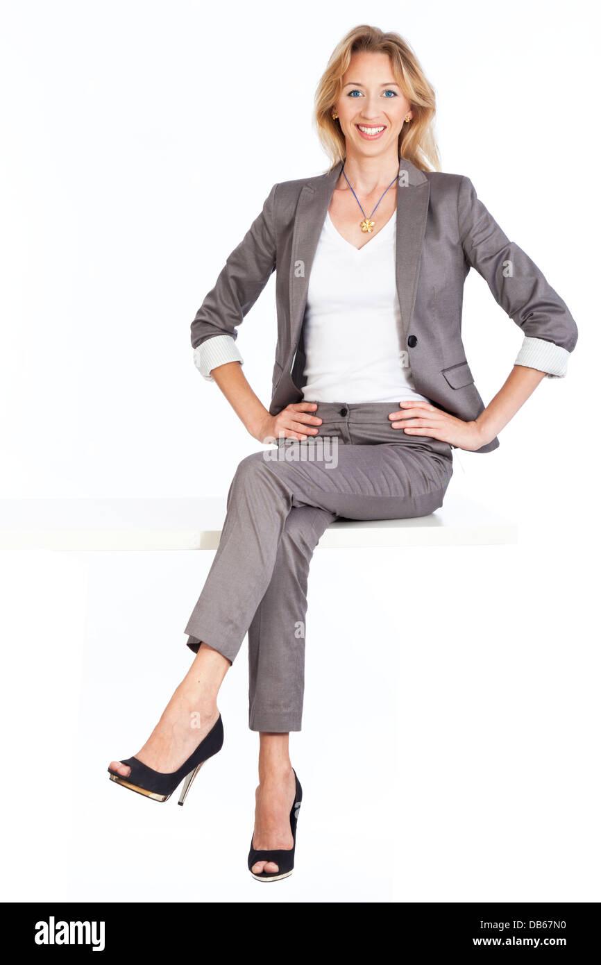 Frau sitzt - Stock Image
