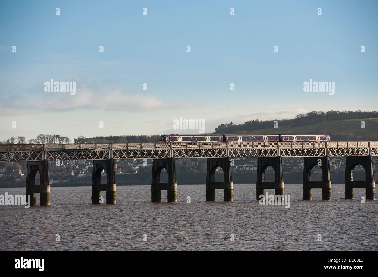 First Scotrail train crossing the Tay Rail Bridge spanning the Firth of Tay, Scotland. - Stock Image