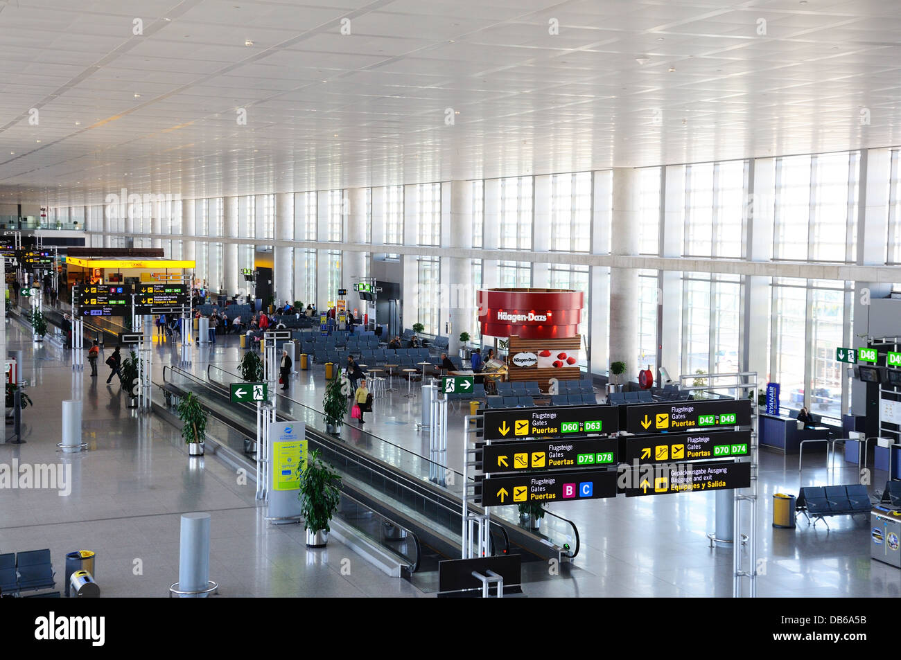 Elevated view inside the airside departures hall, Terminal three, Malaga airport, Malaga, Andalusia, Spain, Western - Stock Image