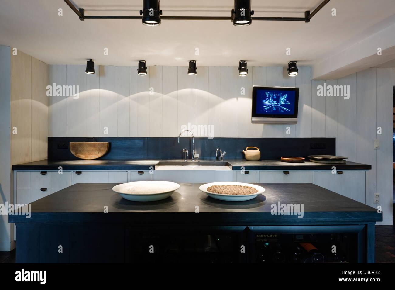 Spotlit kitchen in Antwerp apartment of Boris Vervoordt - Stock Image