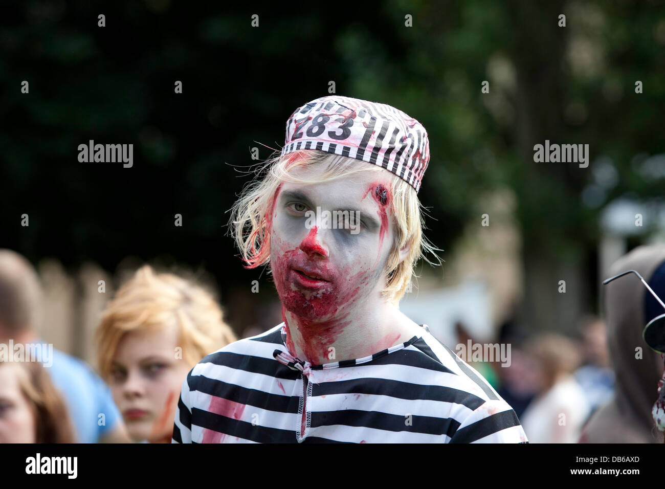 Zombies at Stockholm Zombie Walk 2012. A zombie dressed as a prisoner. - Stock Image