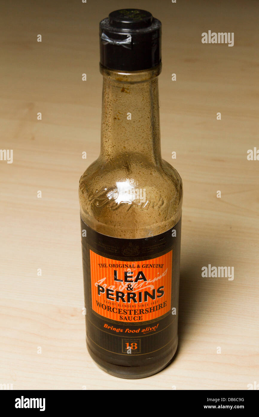 Bottle of Lea & Perrins Worcestershire sauce on a table, England, UK - Stock Image