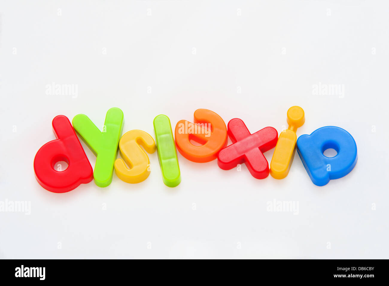 The word dyslexia misspelt in colorful magnetic letters - Stock Image