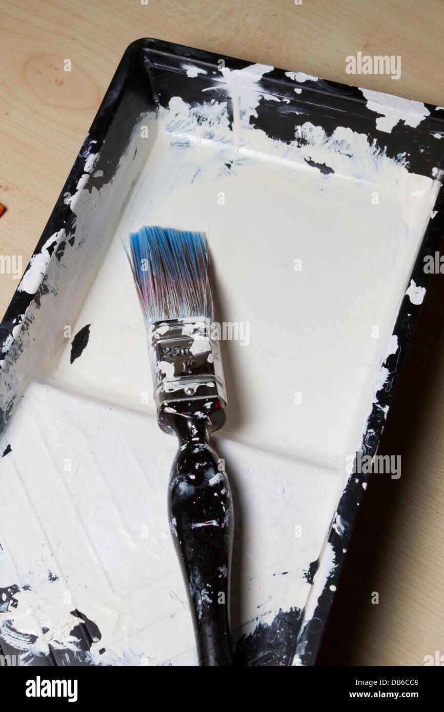 Paint brush in empty tray, England, UK - Stock Image