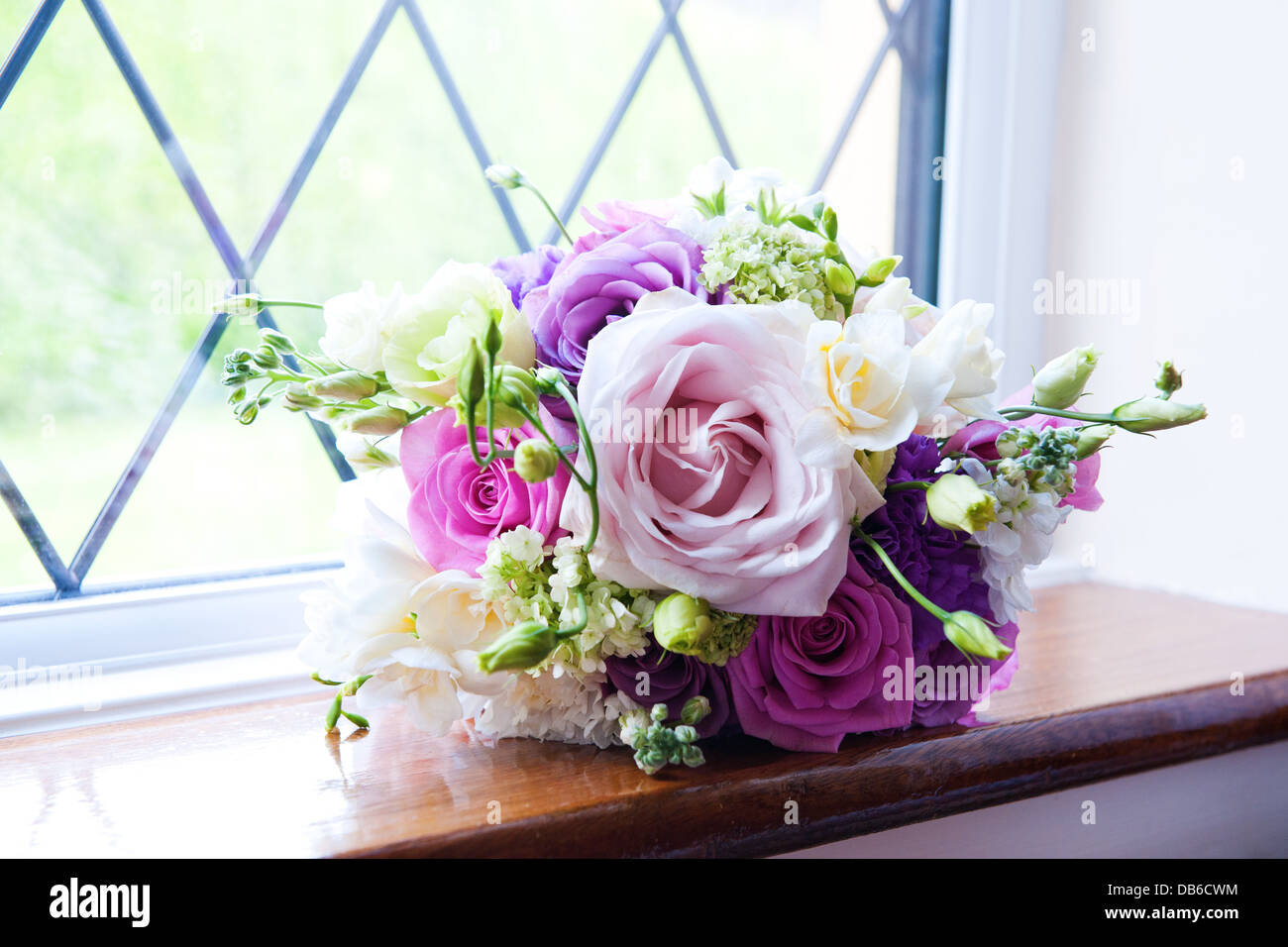 Vibrant Purple Pink White And Pastel Pink Rose Wedding Flower Stock Photo Alamy