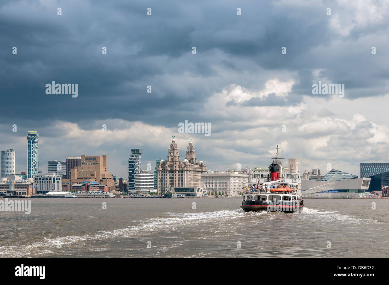 The river Mersey ferry Royal Iris seen from Woodside in Birkenhead with the Liverpool  waterfront skyline in the - Stock Image
