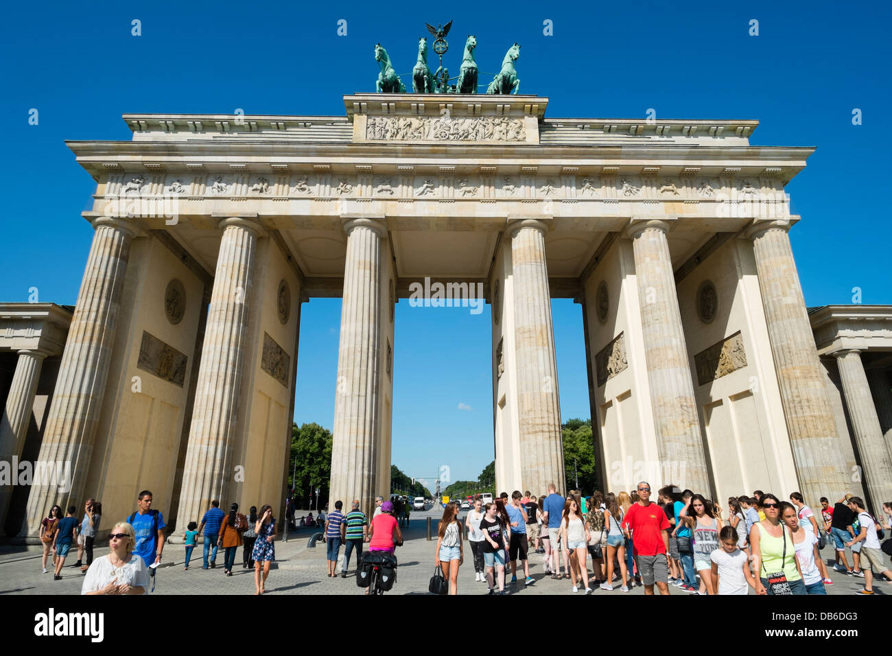 Many tourists at Brandenburg Gate in Berlin Germany - Stock Image