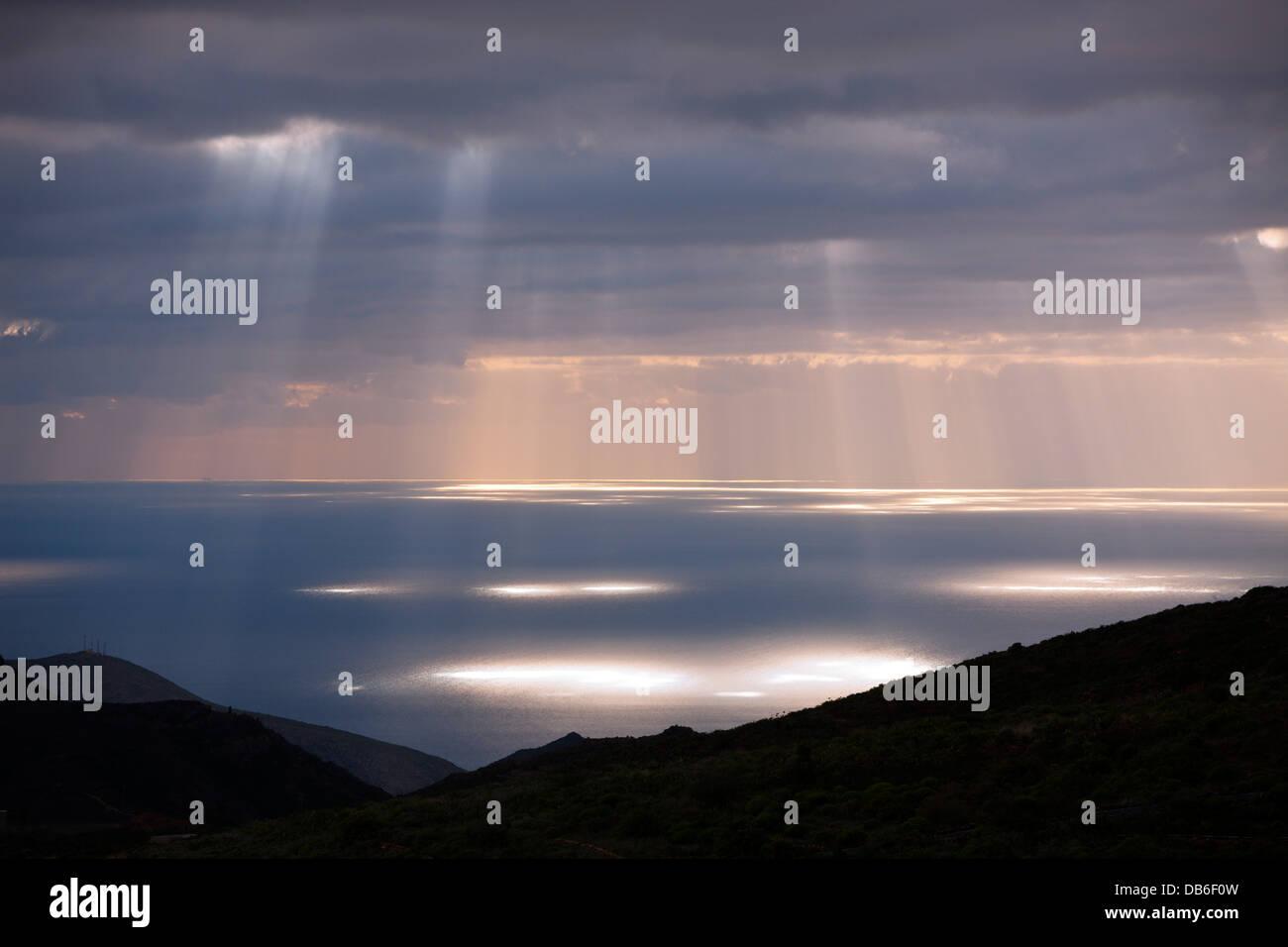 Sun Beams burst through Clouds, Tenerife, Canary Islands, Spain - Stock Image