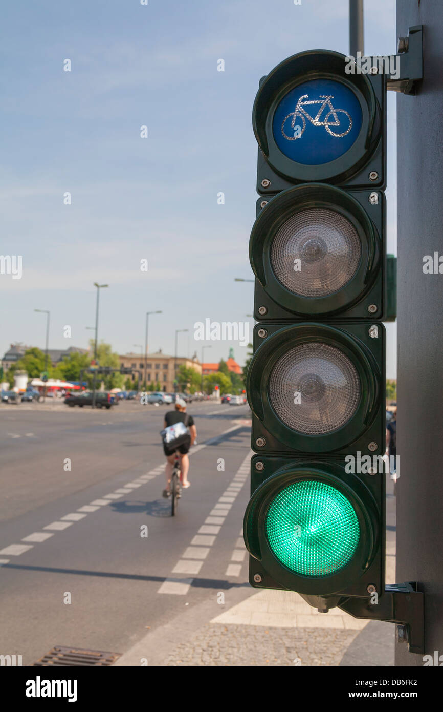 Traffic light for cyclists, bicycle light turns green, a cyclist cross the street Stock Photo