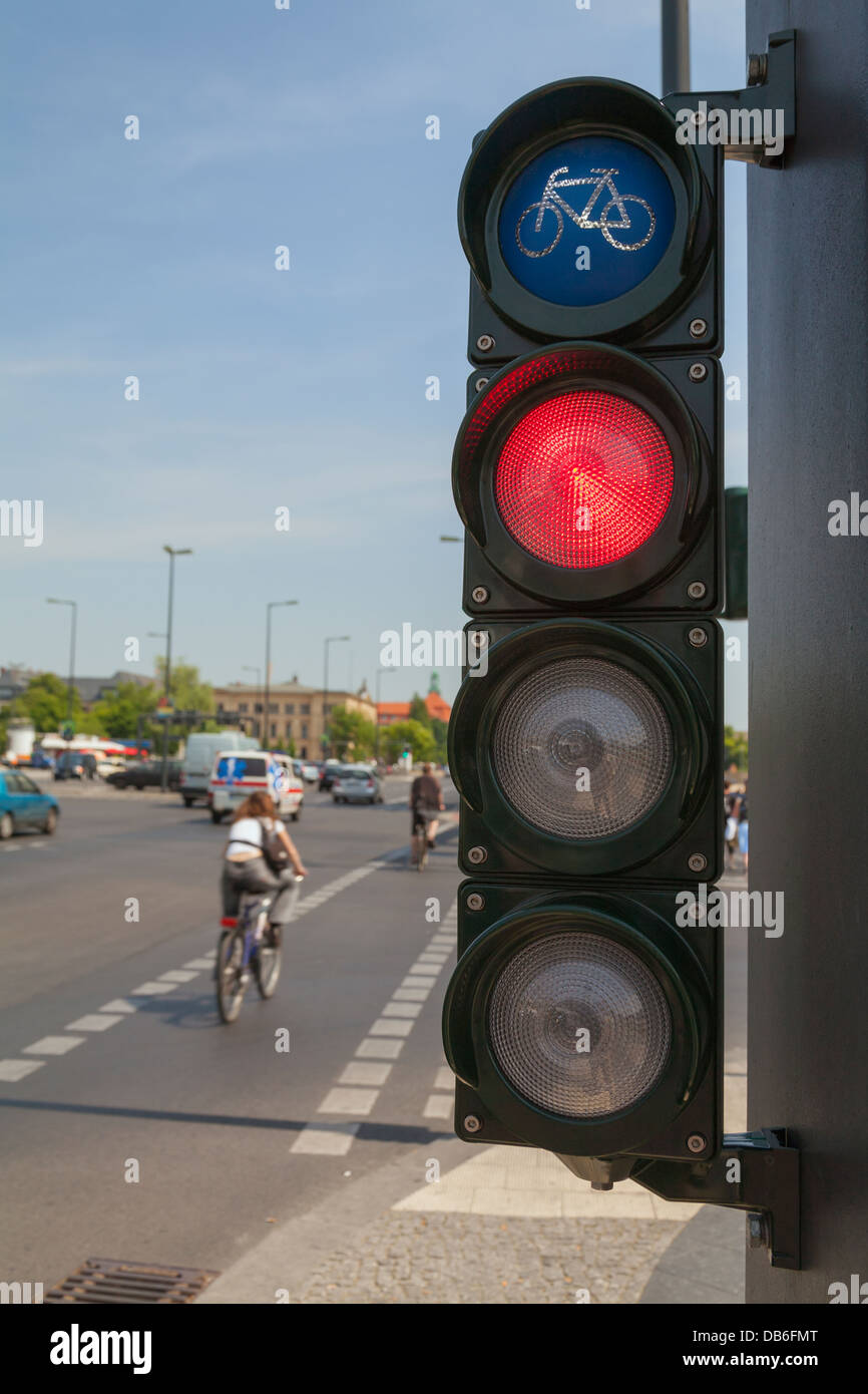 Traffic lights for cyclists; bicycle light turns red, a cyclist cross the street Stock Photo