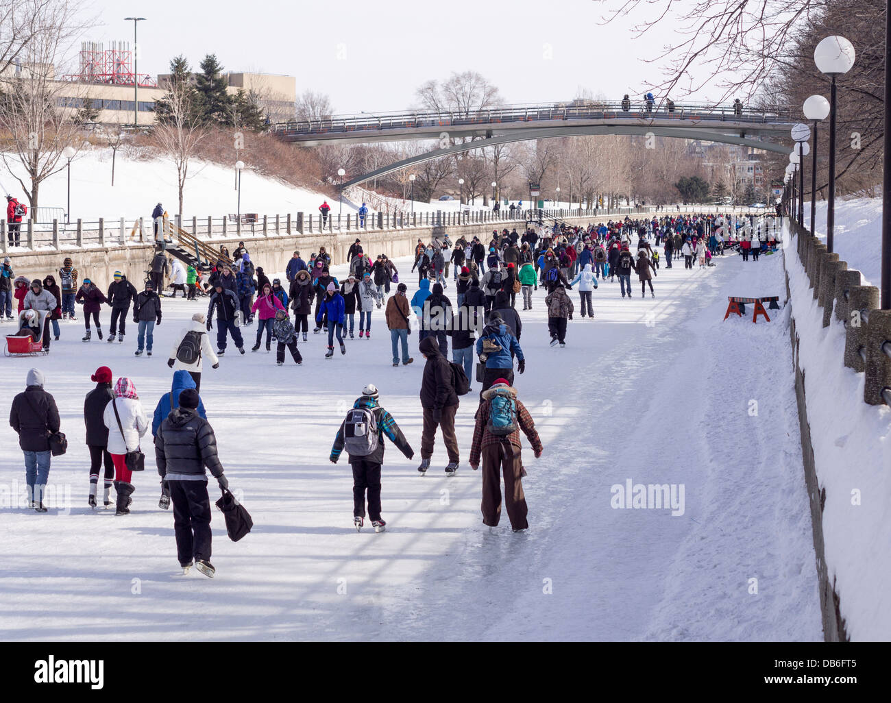 Crowds fill the Rideau Skateway during Winterlude. Large crowds of people take to the ice during Ottawa's winterlude - Stock Image