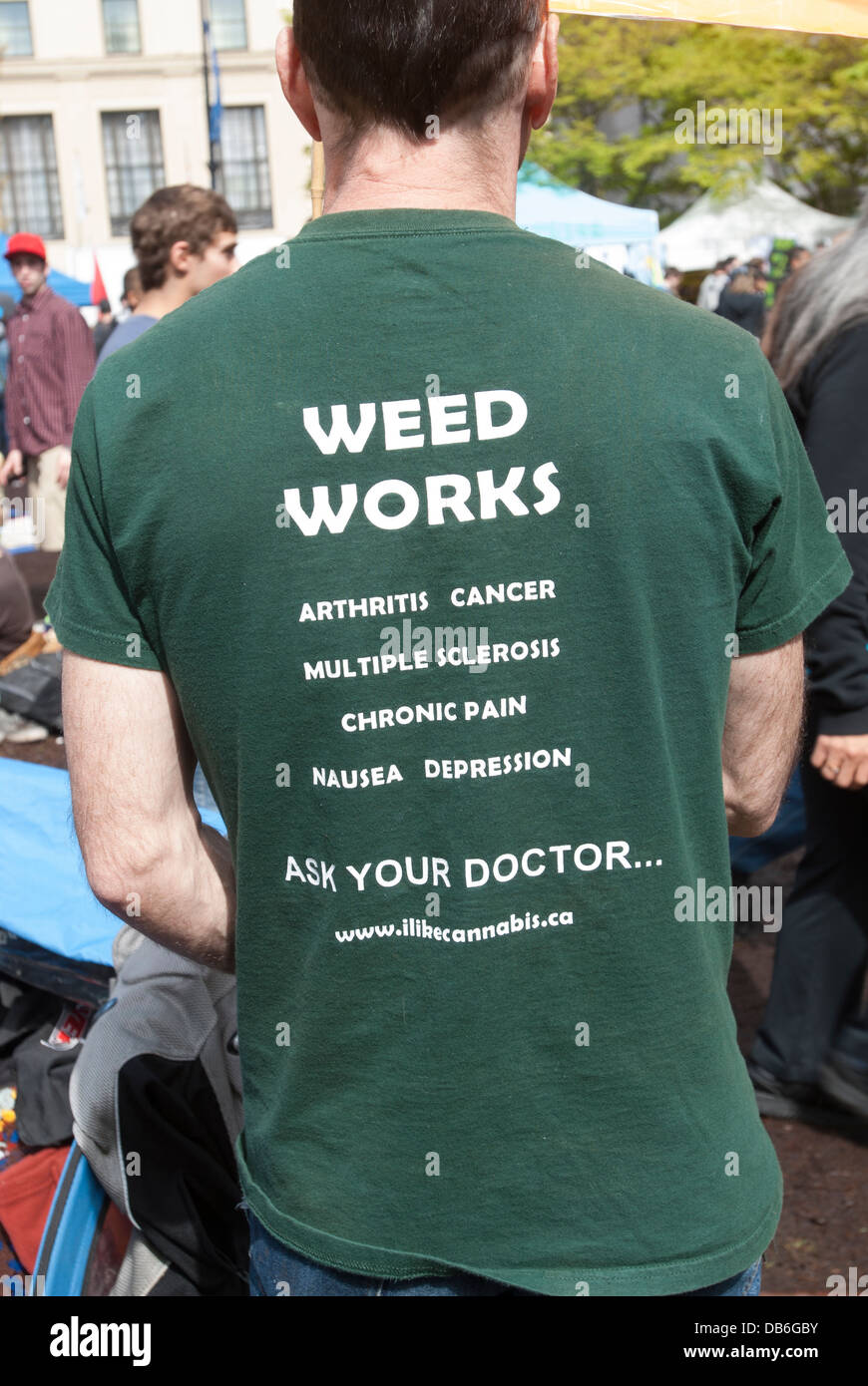 Man wearing t-shirt advertising that marijuana is an aid in certain illnesses. - Stock Image