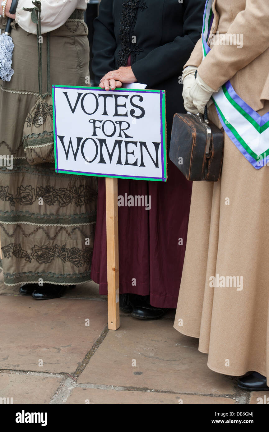 suffragettes holding a votes for women placard at a suffragette movement demonstration - Stock Image