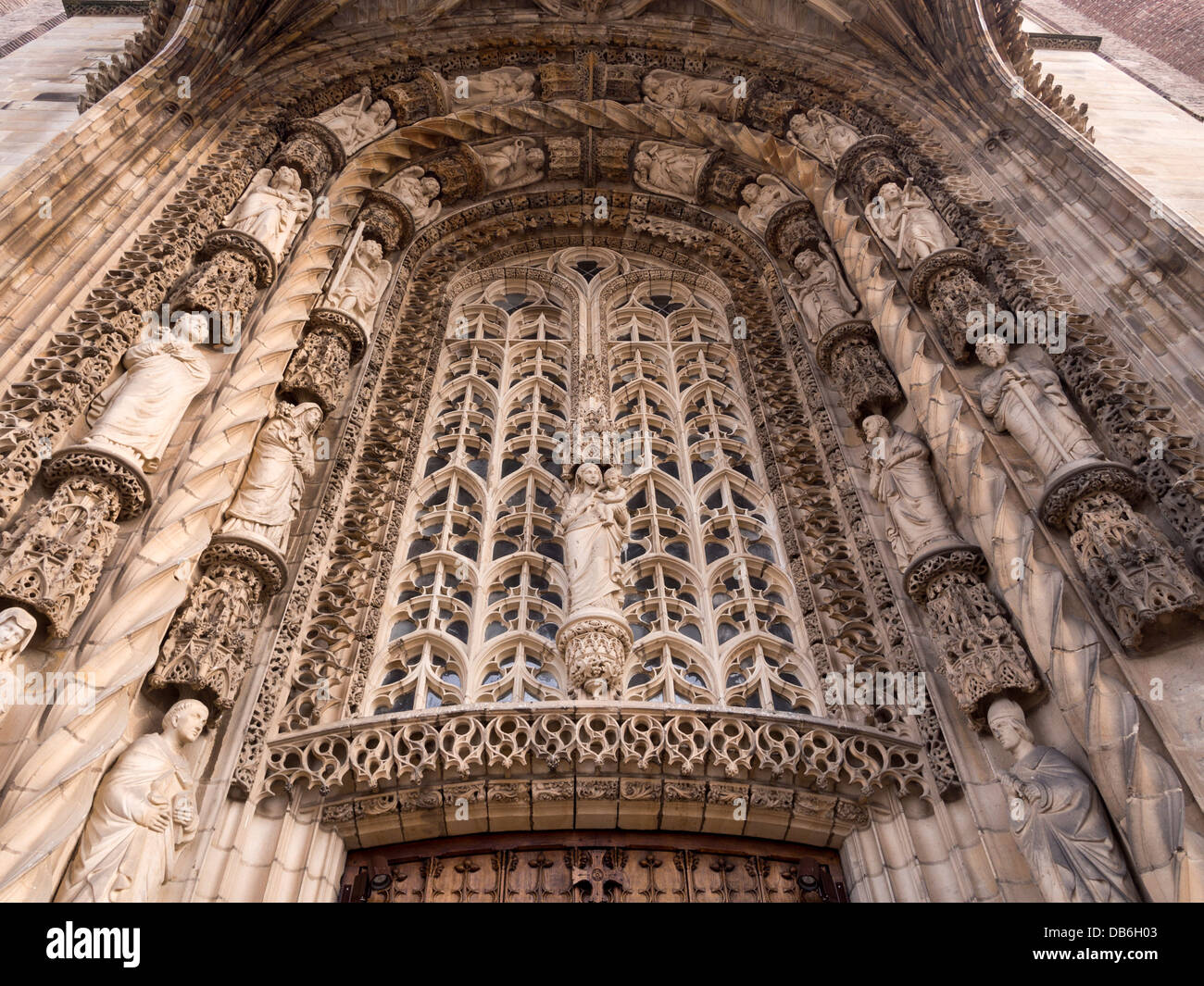 Ornate Carved Stone tympanum . The sculpture above the entrance to the Cathedral is intricately carved stone. - Stock Image