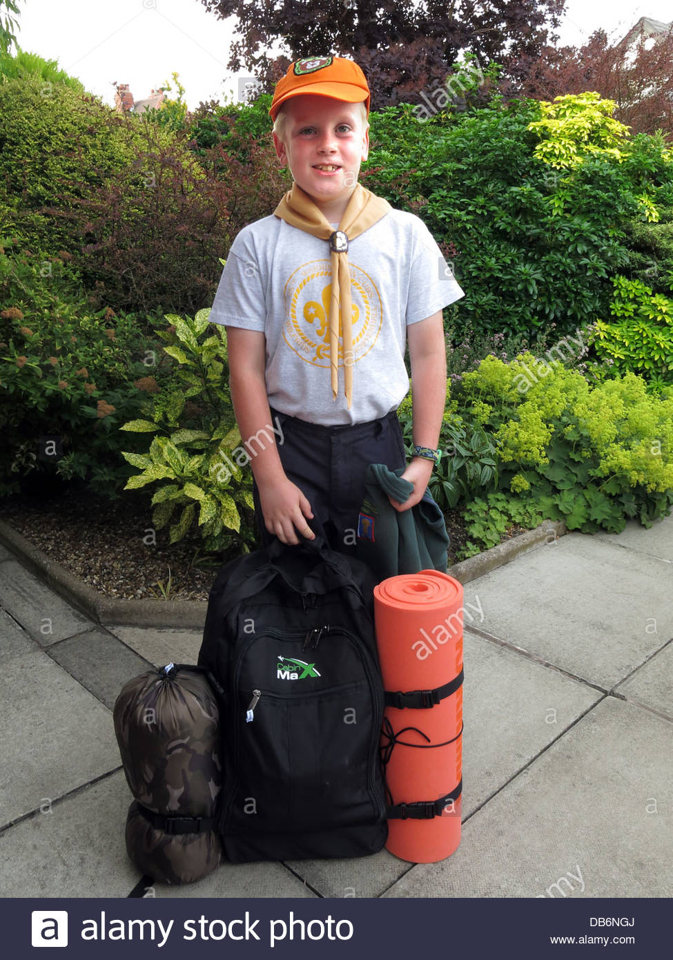 A nine year old cub ready for his summer scout camp in Grappenhall, Cheshire UK - Stock Image