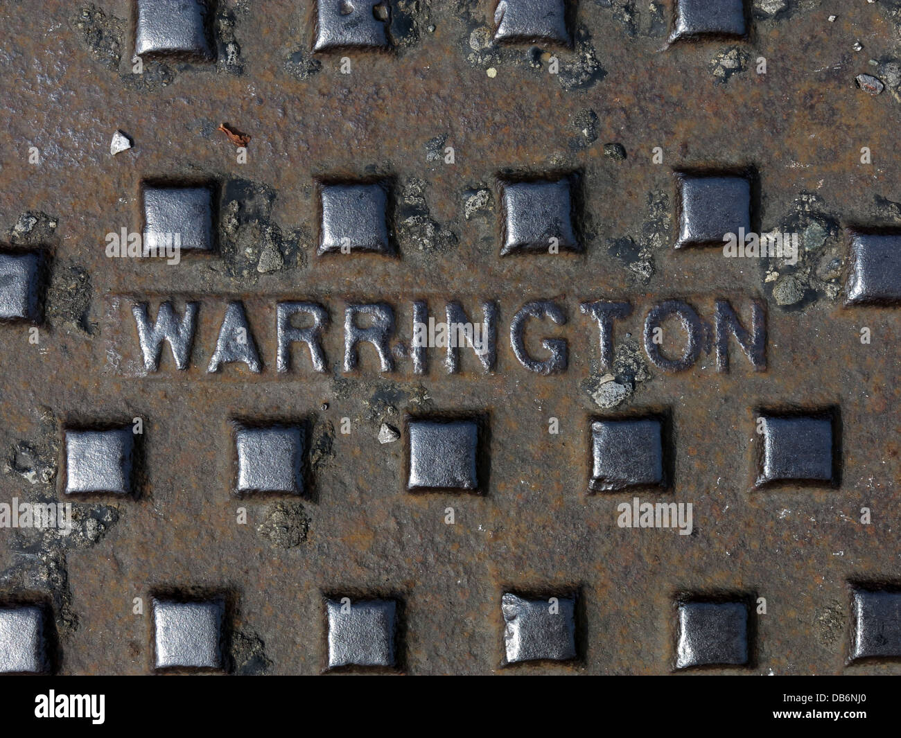 A Grid or man hole  marked with the name of Warrington Cheshire , England UK - Stock Image