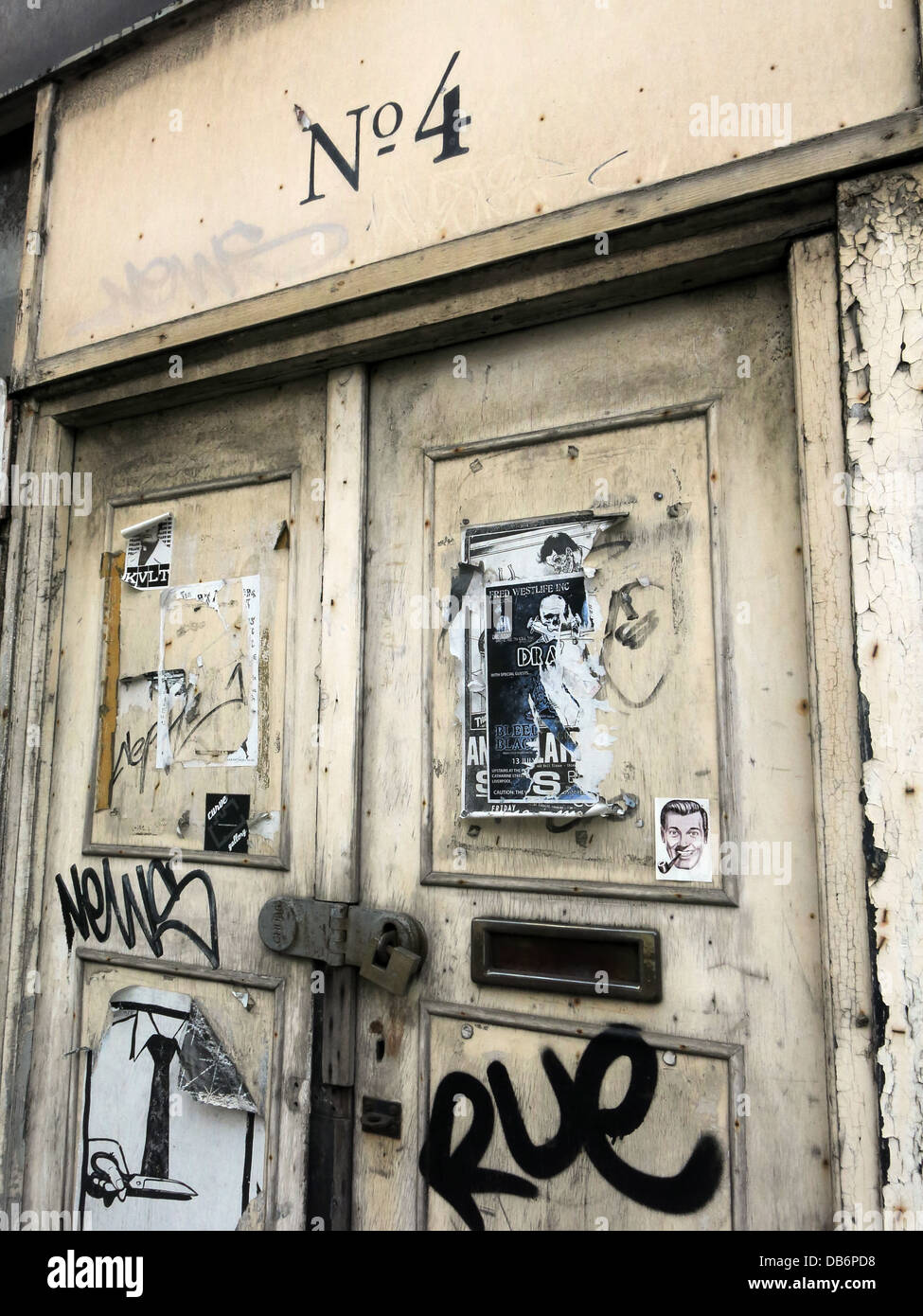 No4, old doorway,abandoned building with posters, Liverpool, Merseyside, North West England, UK - Stock Image