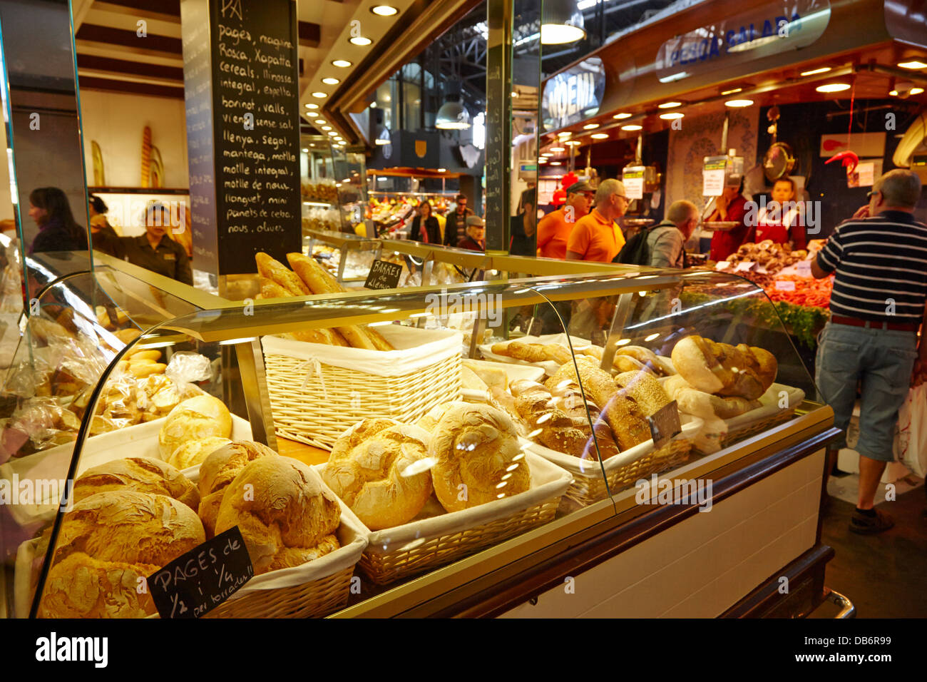 fresh artisan bread for sale inside the la boqueria market in Barcelona Catalonia Spain - Stock Image