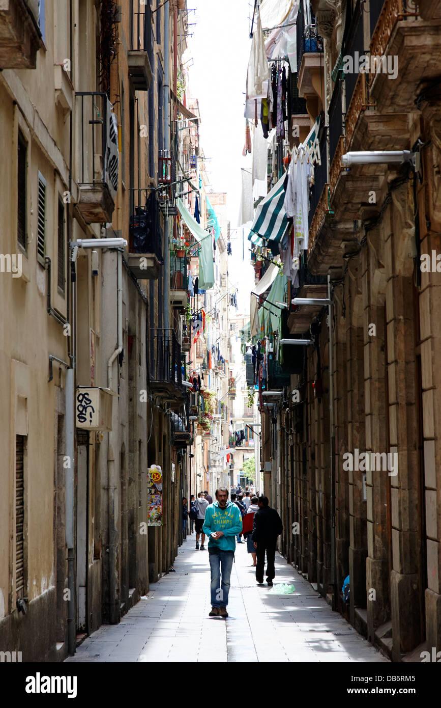 narrow streets in the el raval district of cuitat vella Barcelona Catalonia Spain - Stock Image