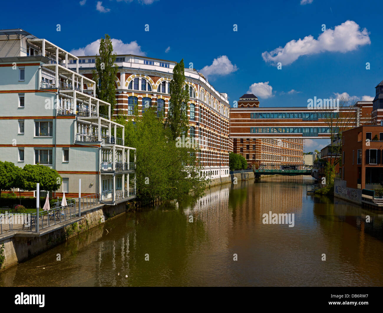 Loft apartments in former spinning mill at White Elster River, Leipzig, Saxony, Germany - Stock Image