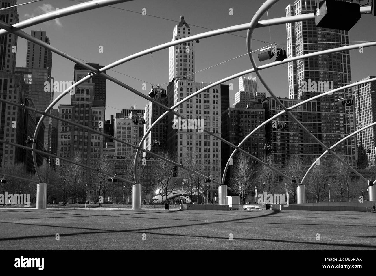 Black and white photograph of Michigan Avenue seen through the grid of the bandstand in Millennium Park, Chicago, - Stock Image