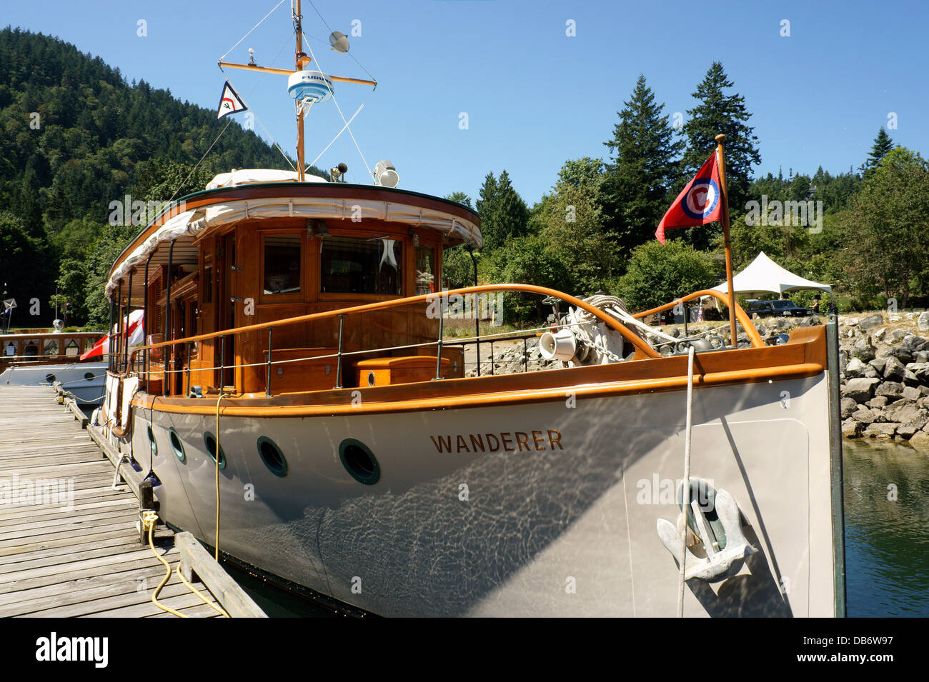Vintage wooden cabin cruiser Wanderer docked at Snug Cove on Bowen Island, BC, Canada - Stock Image
