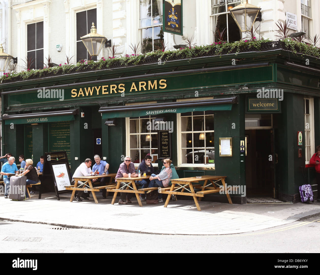 Sawyers Arms, a pub in Central London with drinkers outside in the sun enjoying their pints, near Paddington Station, - Stock Image
