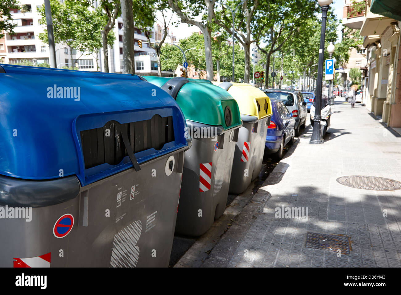 communal kerbside recycling bins for apartment block in Barcelona Catalonia Spain - Stock Image