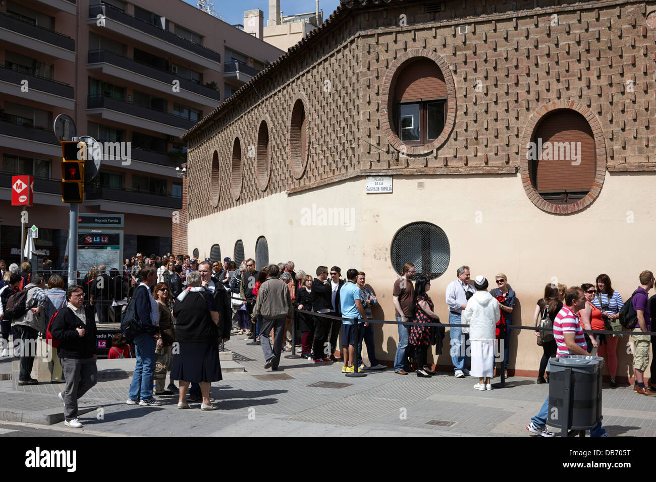 tourists and visitors in long queue to enter the Sagrada Familia Barcelona Catalonia Spain - Stock Image