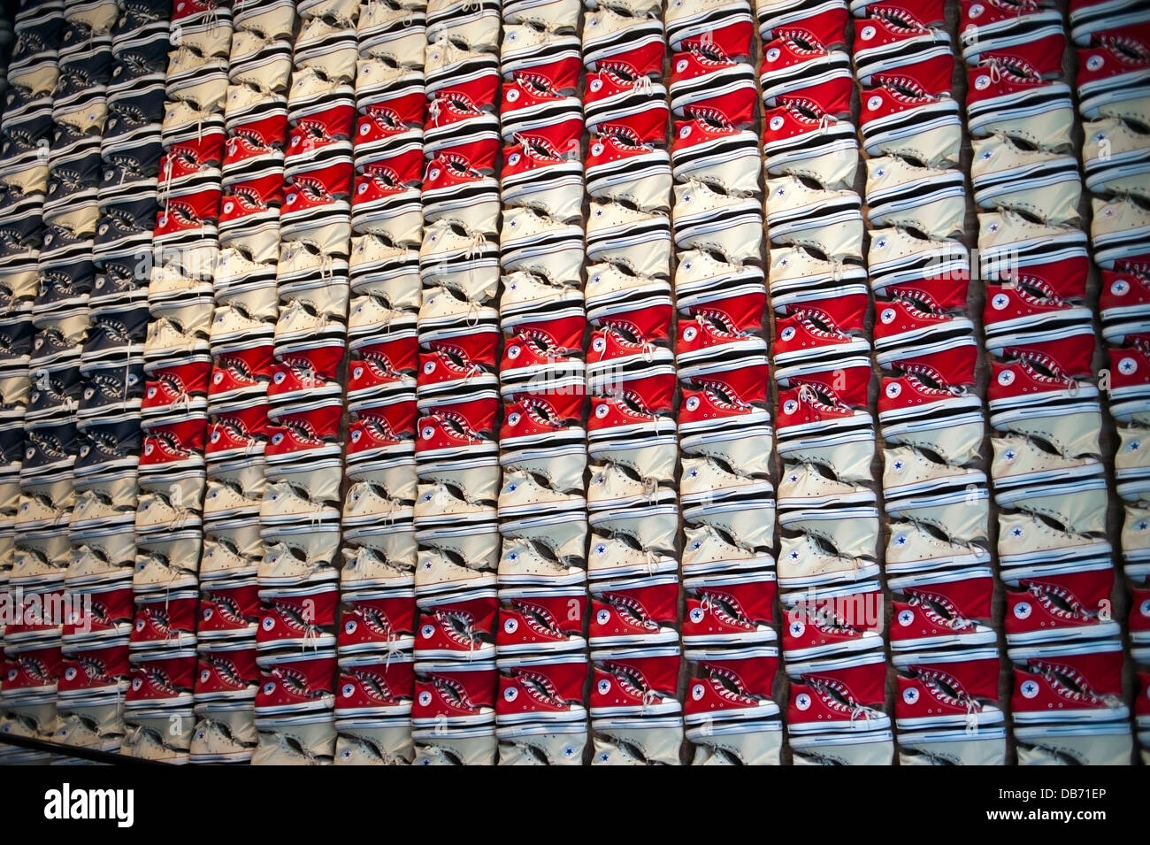 Converse Chuck Taylor All Stars tennis shoes displayed on the wall at the Converse Shoe store in New York City - Stock Image
