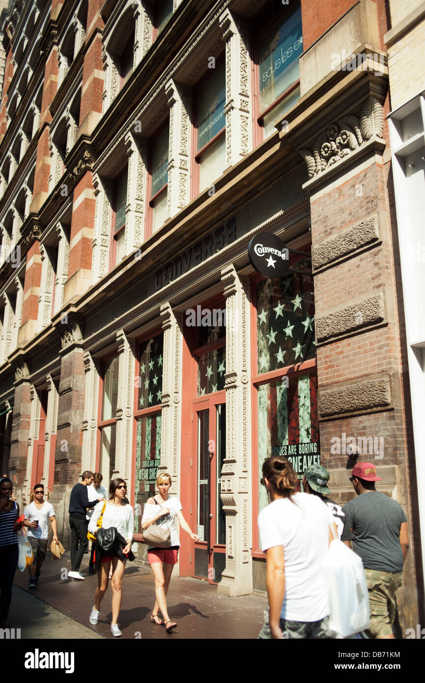 People walking in front of the Converse Shoe store in New York City - Stock Image