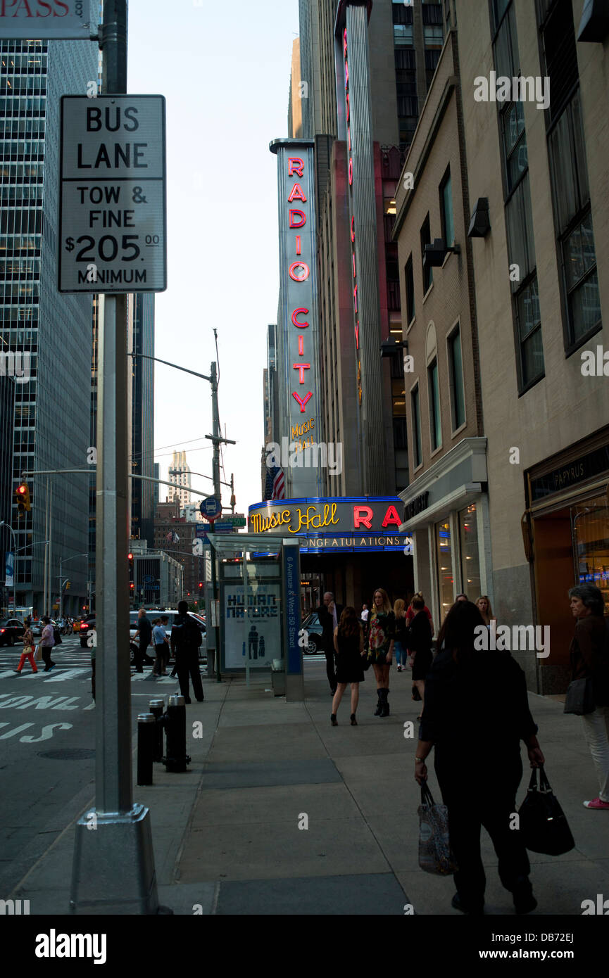 People walking in front of Radio City Music Hall in New York City - Stock Image