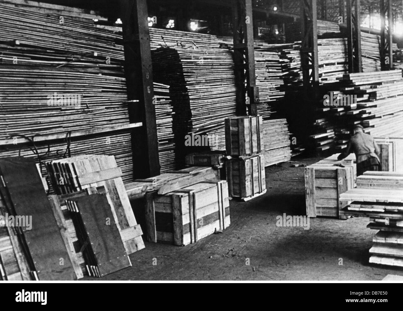 post war period, reconstruction, warehouse with wooden planks and wooden boxes, 1945 - 1949, Additional-Rights-Clearences - Stock Image