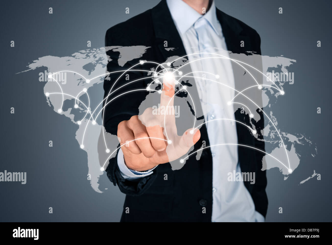 Portrait of handsome businessman touching a world map on the screen showing global connection between different - Stock Image