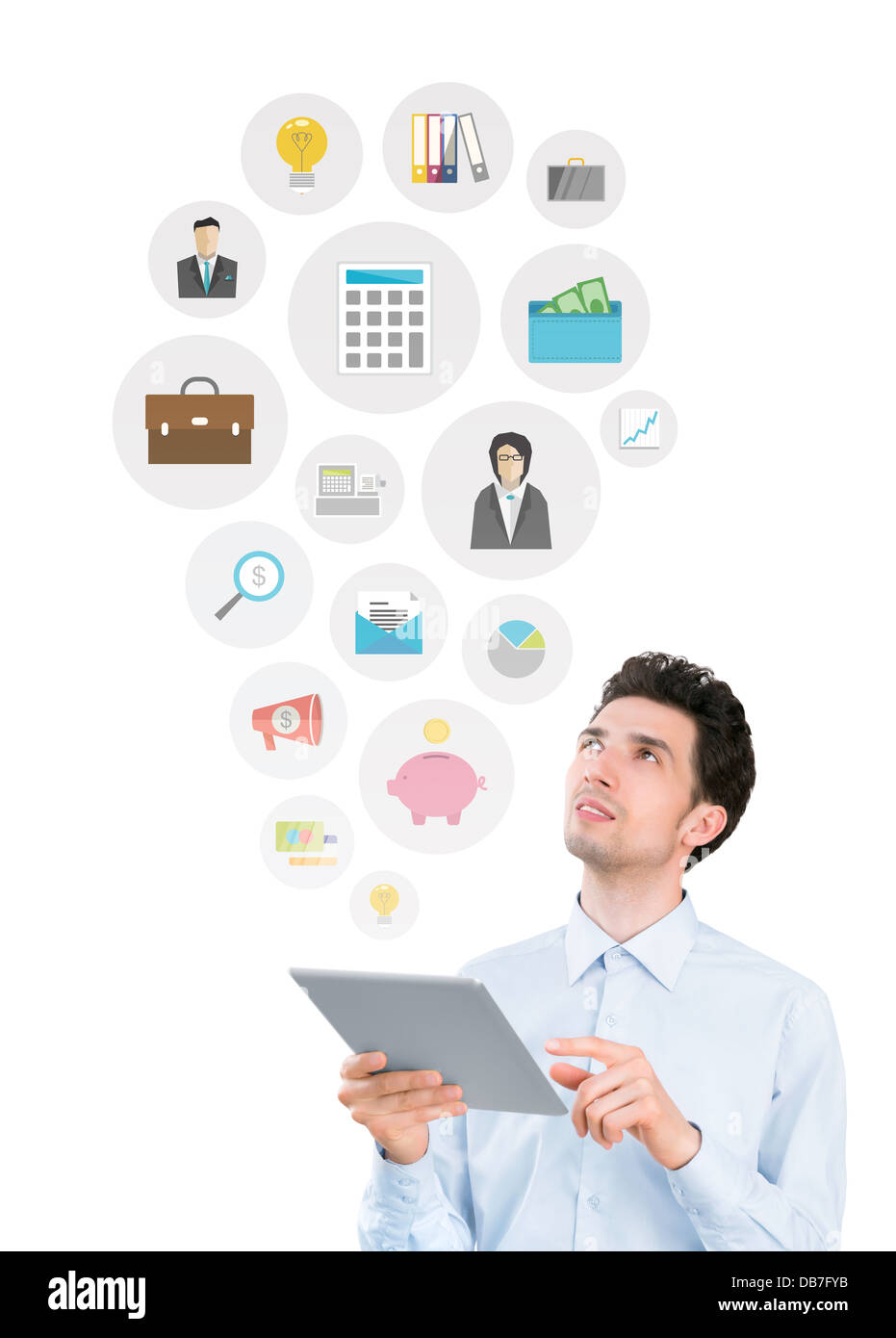 Young man holding digital tablet computer and looking on collection of mobile application icons on business and - Stock Image