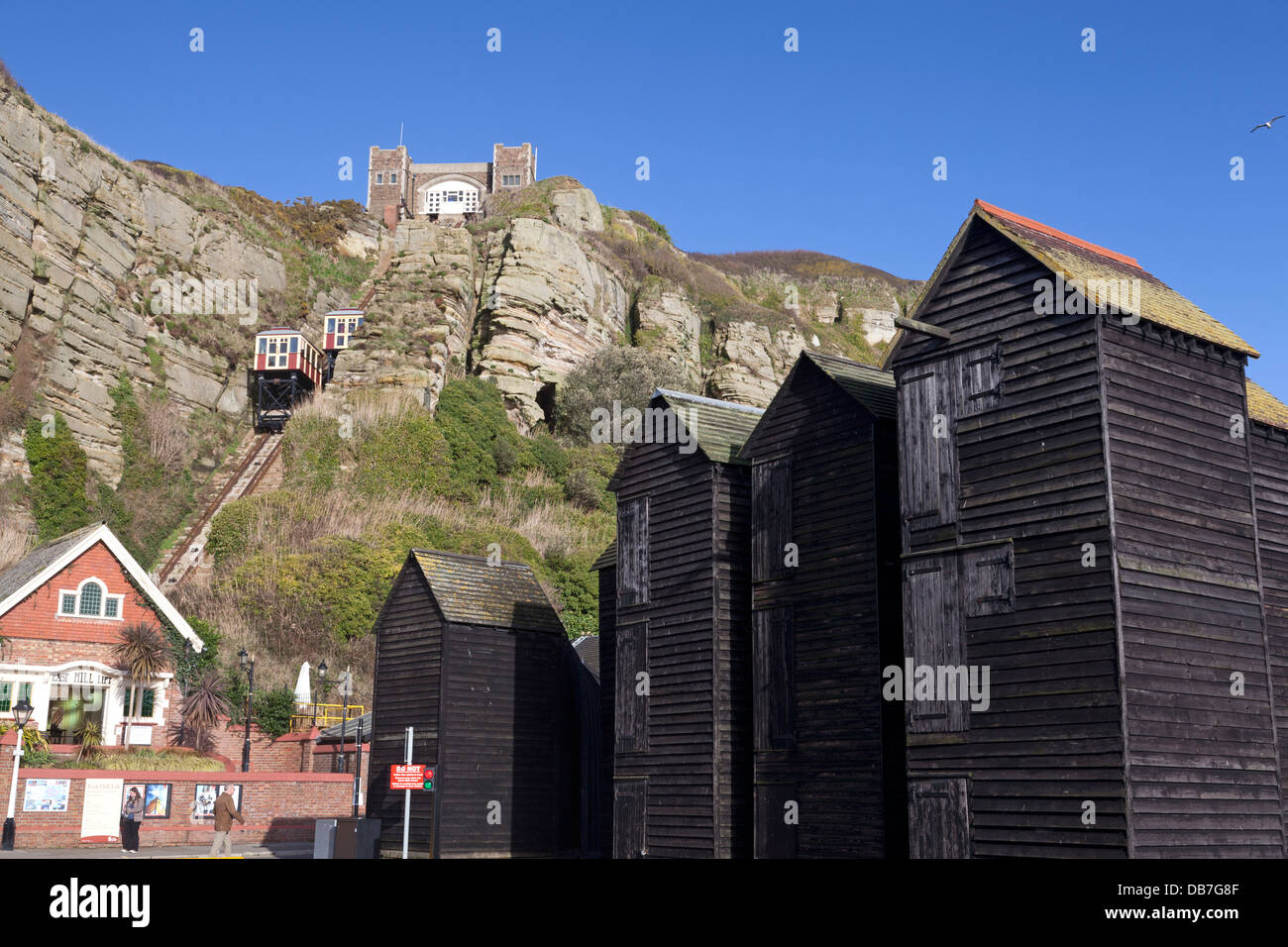 Net Huts in Hastings Old Town, with East Hill funicular railway in background, East Sussex - Stock Image
