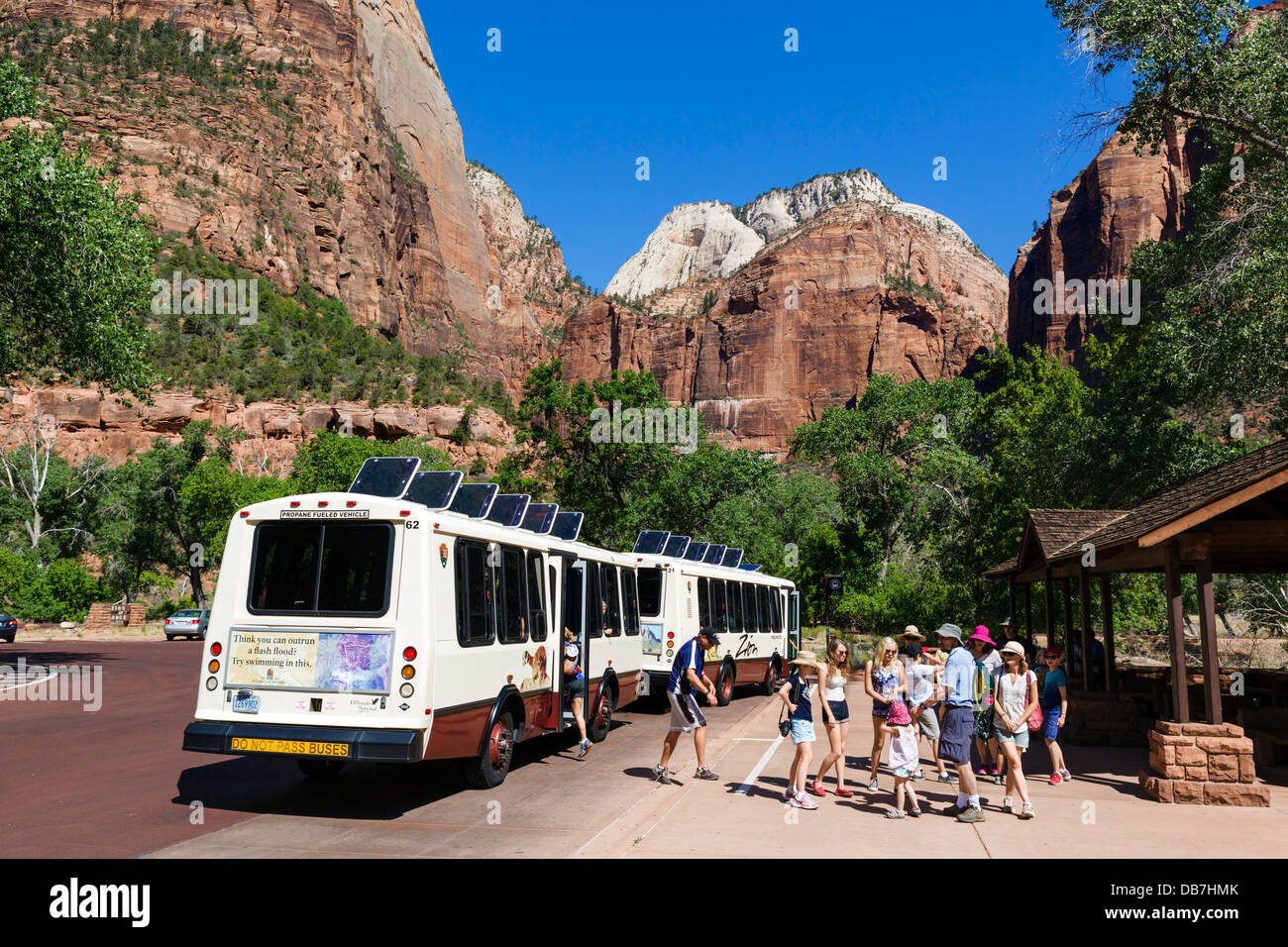 Tourists getting off the shuttle bus at Zion Lodge, Zion Canyon, Zion National Park, Utah, USA - Stock Image
