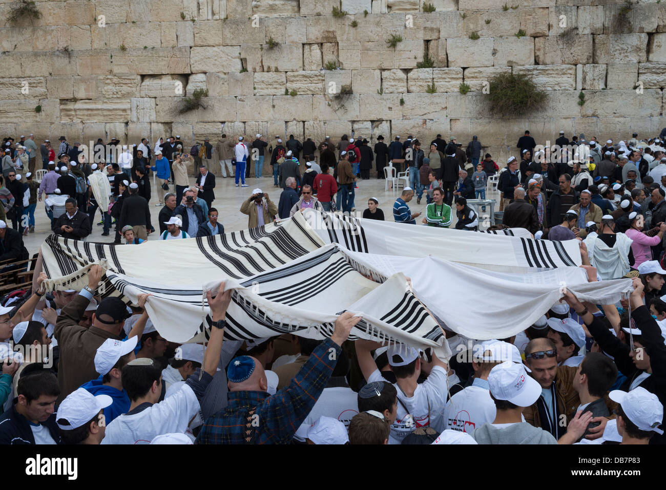 Worshippers holding prayer shawls above their heads. Western Wall. Jerusalem Old City. Israel. - Stock Image