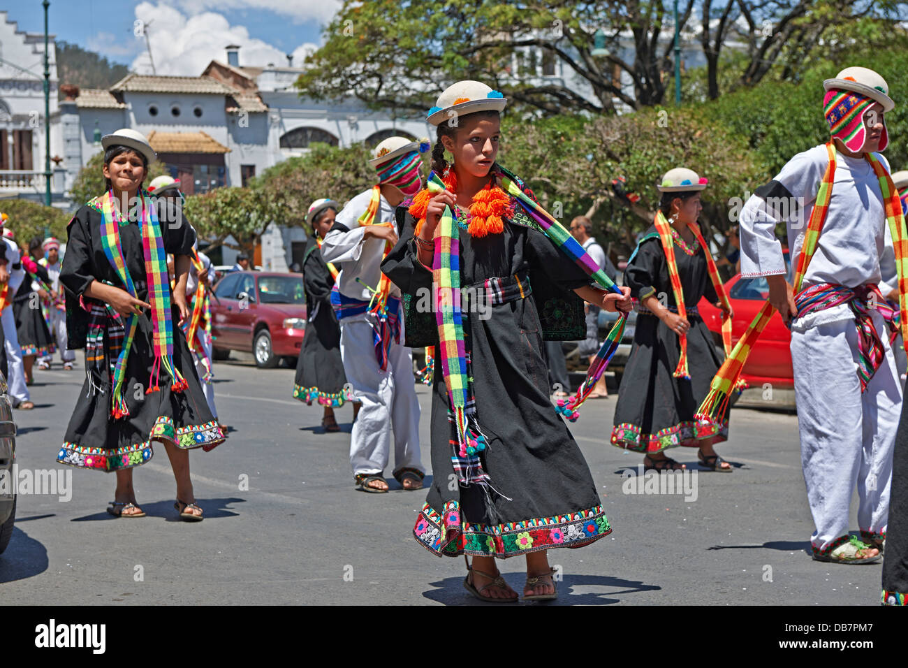 indigenous people with traditional costumes dancing in the street of Sucre, Bolivia, South America - Stock Image
