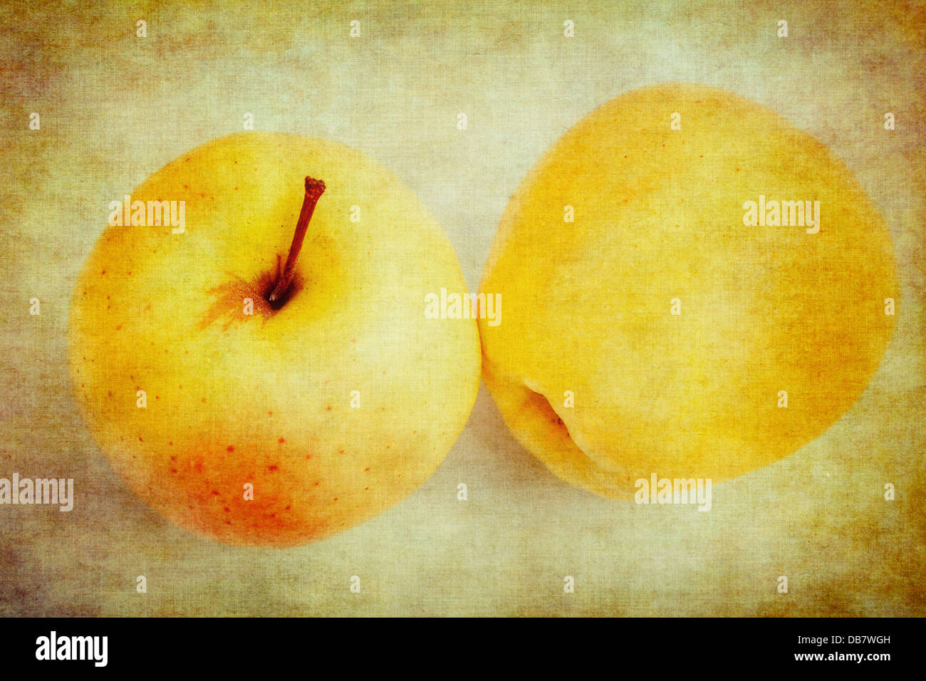 Abstract textured studio shot of two golden delicious apples. - Stock Image