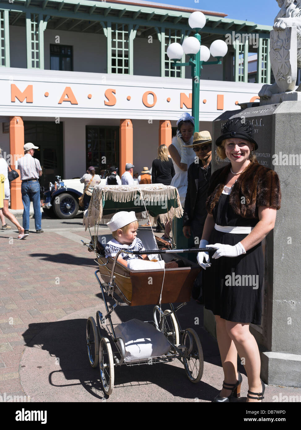 dh  NAPIER NEW ZEALAND Art Deco festival mother and pram baby child 1930s dress woman style - Stock Image