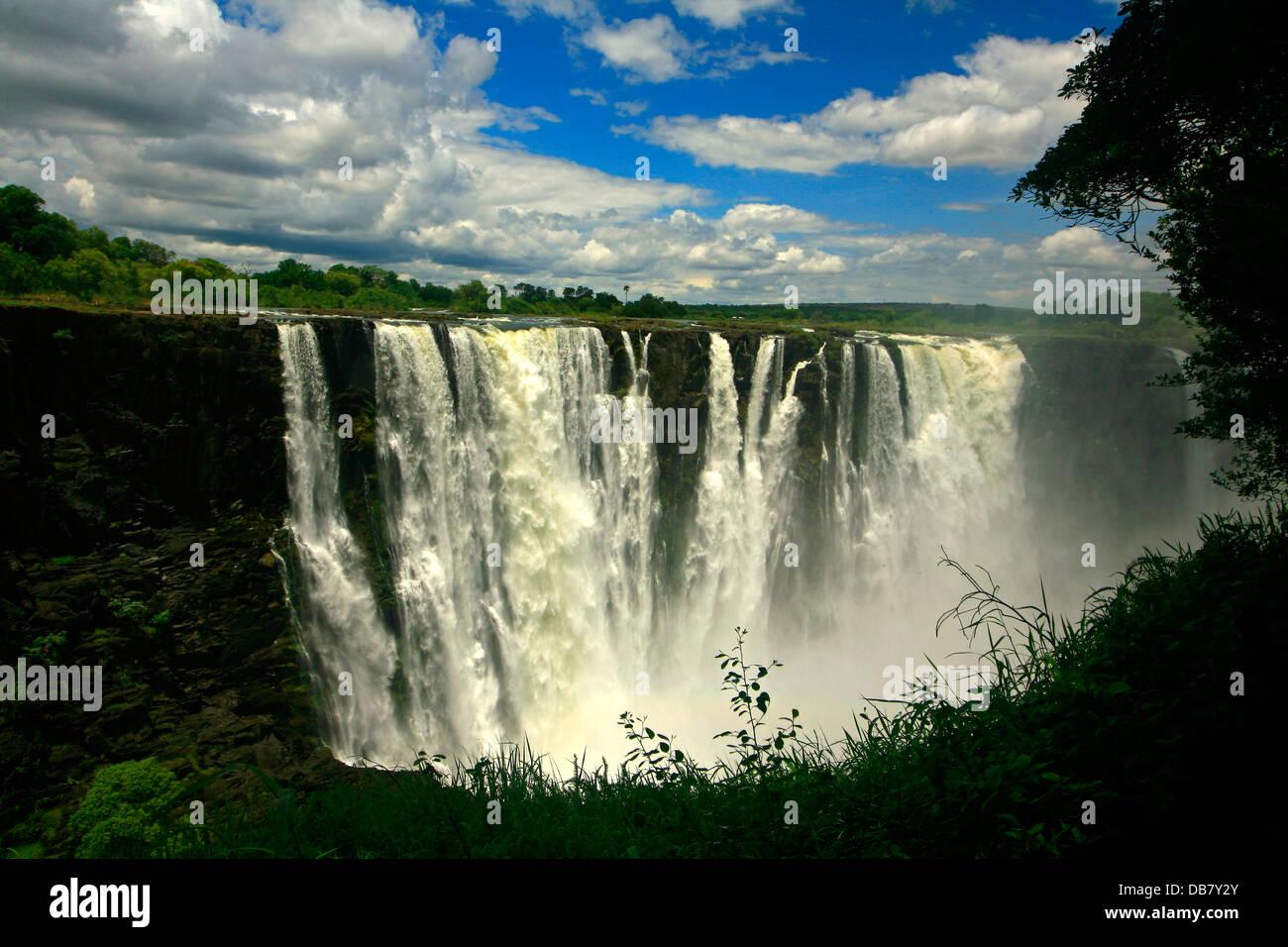Zimbabwe - Victoria Falls waterfall rushing water icon Africa fleecy white clouds blue sky.�Jeremy Jowell/Moonshine - Stock Image