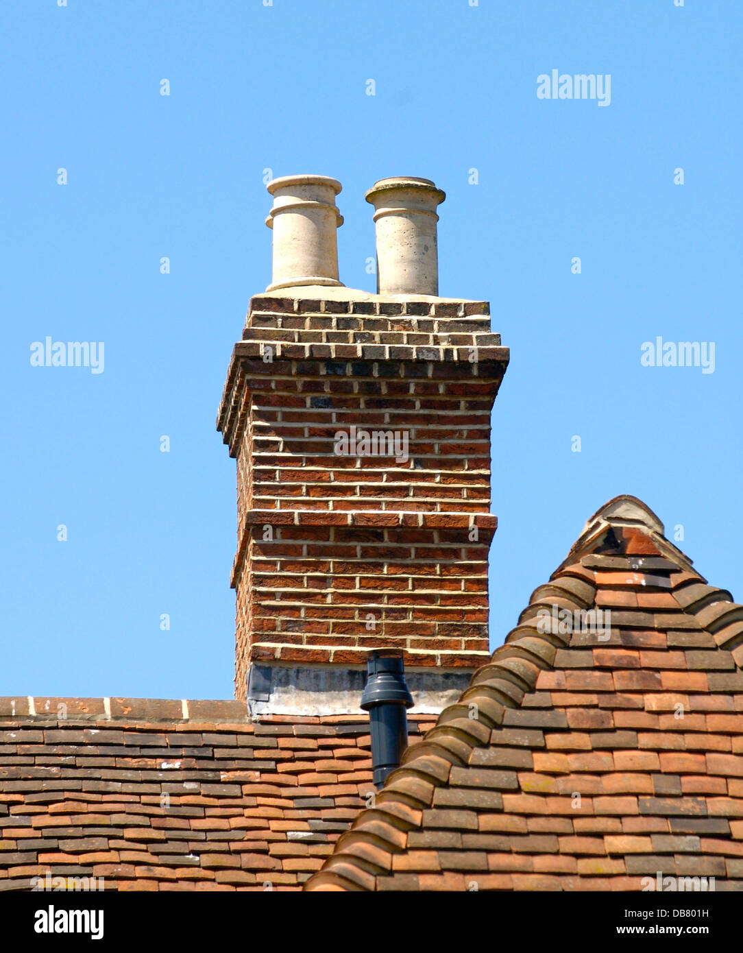 Old chimney pots on a roof in UK - Stock Image