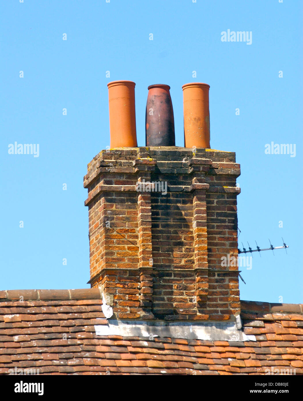 old chimney pots on a roof in uk stock photo: 58568454 - alamy