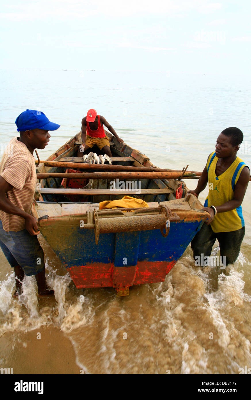 Industry - Fishing fishermen boat catch in Angola launhcing fishing boat in surf catch day ocean,�Jeremy Jowell/Moonshine - Stock Image