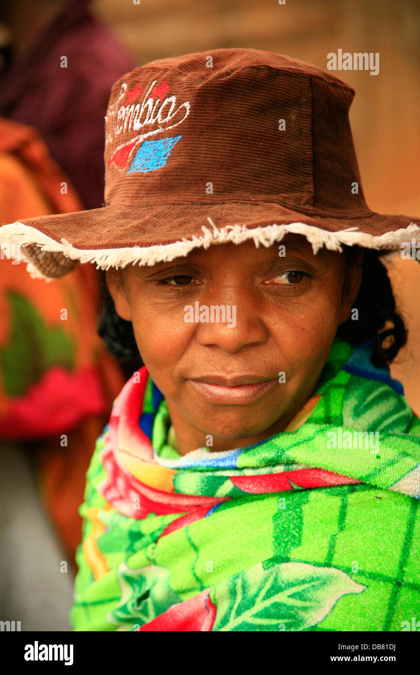People - African woman Madagascan woman wearing hat green shawl colours Madagascar sad face,�Jeremy Jowell/Moonshine - Stock Image
