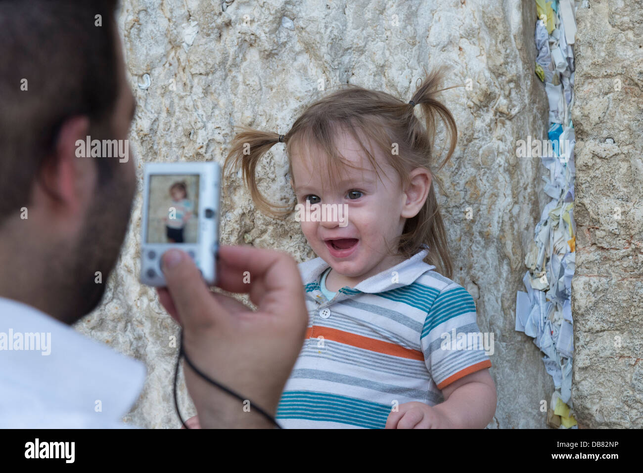 Young toddler pausing and being photographed. Western Wall. Jerusalem Old City. Israel. - Stock Image