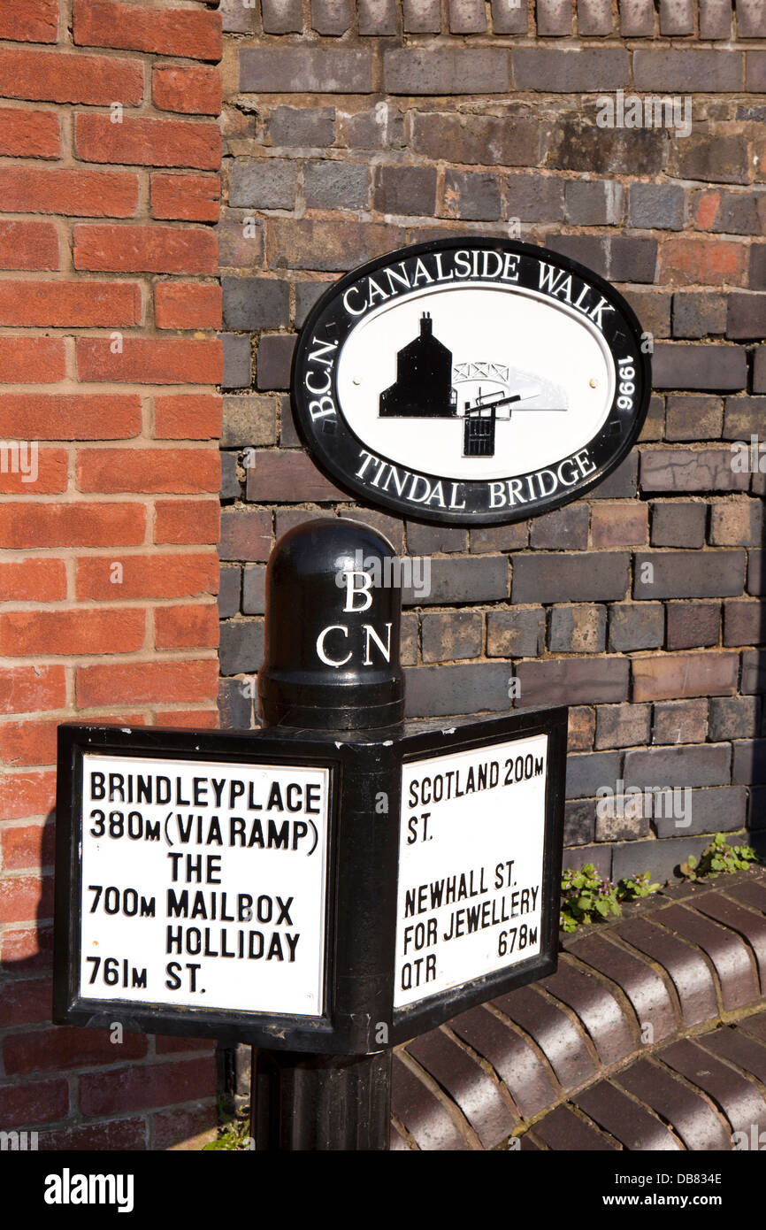 UK, England, Birmingham, Brindley Place, towpath walk signpost on Birmingham and Fazeley Canal at Tindal Bridge - Stock Image